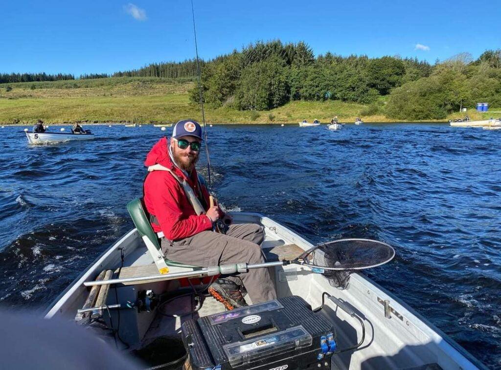 Mark fly fishing from a boat at Llyn Brenig