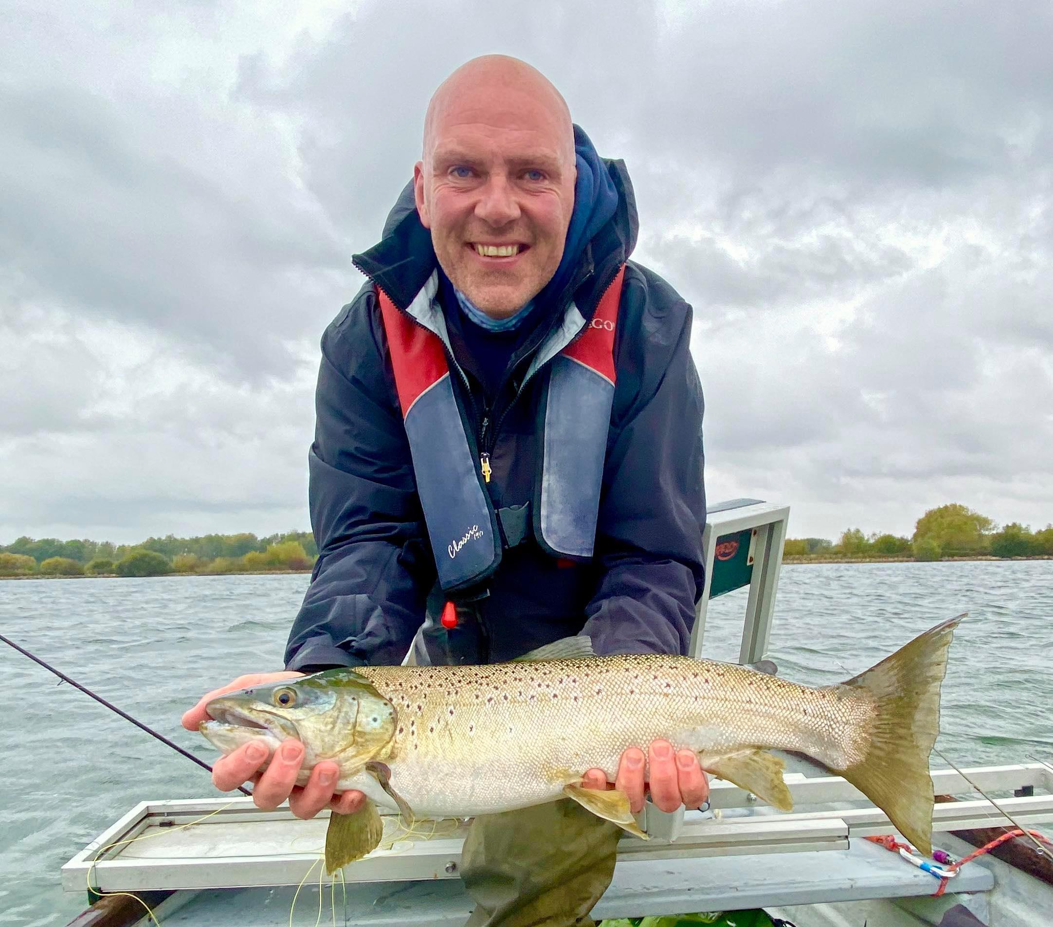 Gaz Jones with a 7 pound brown taken on a black humungous lure at Rutland water