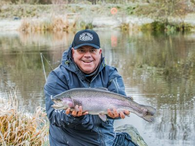 Jim Crawford with a cracking small still water rainbow trout