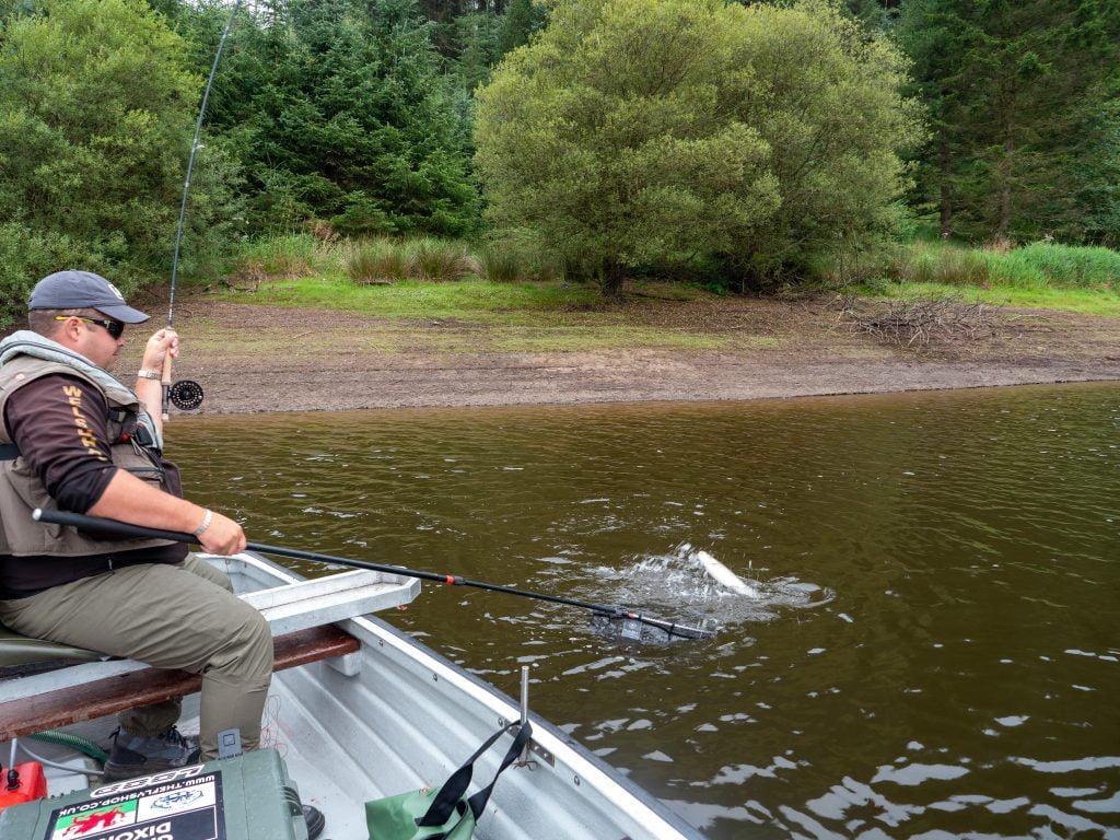 Gareth Dixon playing a Llyn Clywedog rainbow trout