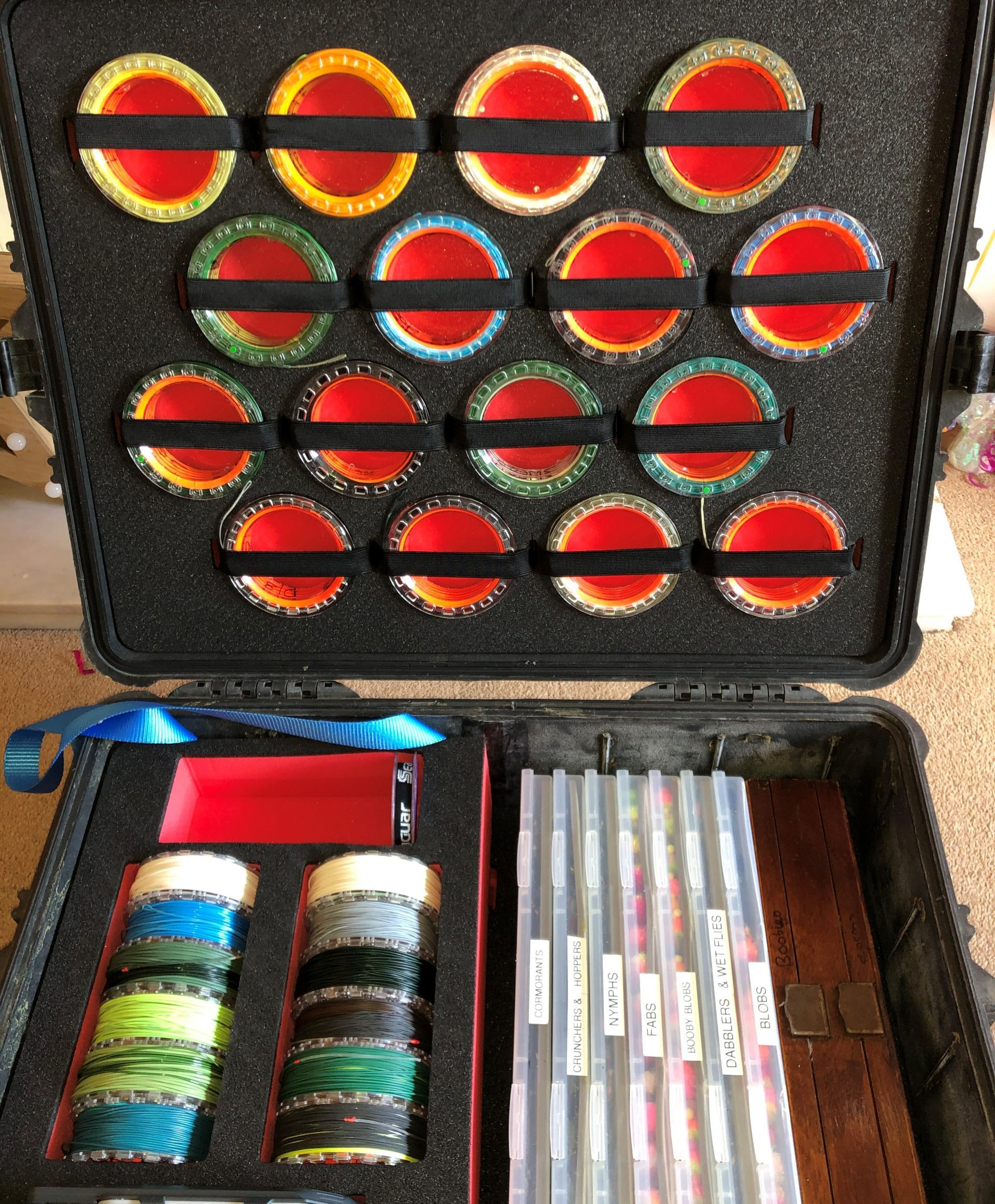 Wayne Jones shows his fly fishing box with lines in