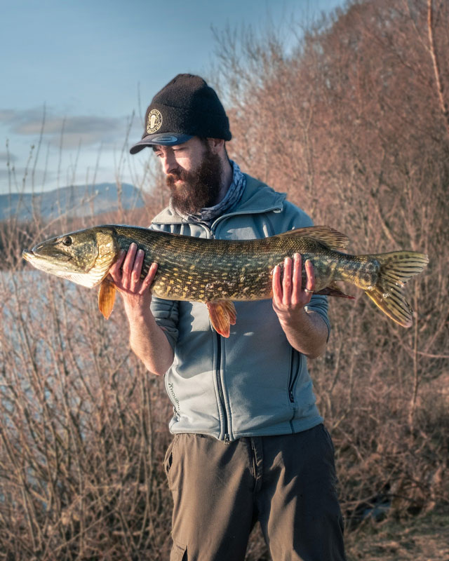 Man holding Pike Catch