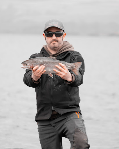 Man with Rainbow Trout Catch