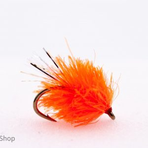 fluorescent orange blob with sparkler tail scaled